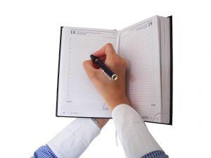 1182878_woman_writing_in_the_agenda.jpg